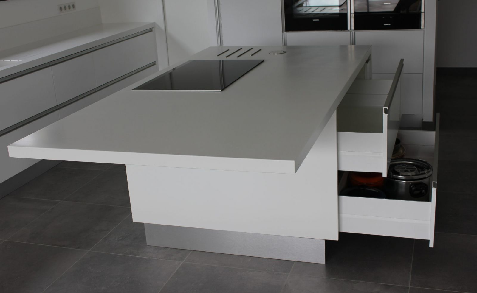 Abmi for Ilot central avec table de cuisson
